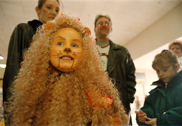 "3/15/97-- cowardly lion--Takaaki Iwabu photo-- Gianna Mantell, 5, Niagara-Wheatfield, waits for her turn to be on the stage when she gets dressed-up as ""Cowardly Lion"" during the ""Wizard of Oz"" dress up contest at Summit Park Mall Saturday. <br /> <br /> grapevine photo"