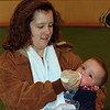 98/02/06 Winterfest 8 *Dennis Stierer photo - Wendy Oates feeds her son Richard, 9 months some power food prior to the Indoor Baby Races.       BLACK AND WHITE PHOTO