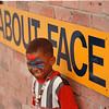 7/17/97 Art Park 2 - James Neiss Photo - Ravon Reed 4yrs of Center Court, is all smiles after painting his face in war paint fashion at one of art parks activities areas.