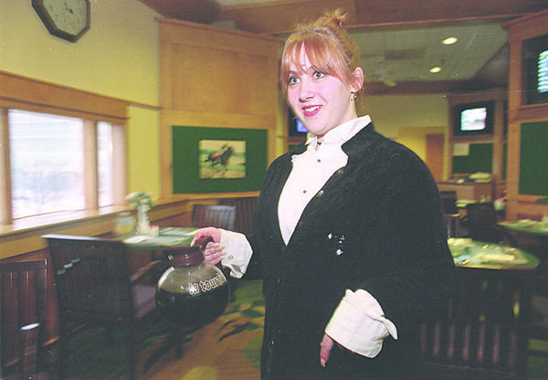 1/19/97-- waitressing --Takaaki Iwabu photo-- Brandie Harrison, Niagara Falls, works at OTB Clubhouse as a waitress. (for Liz story on people handling two jobs)<br /> <br /> Sunday, color