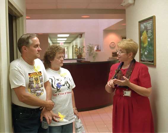 98/07/29 Hospice Tour *Dennis Stierer Photo -<br /> Sue Ellen Zagrabelny with Niagara Hospice talks to George and LaVonne Walker about the many facets of Niagara Hospice as she takes them on a tour of the facility.