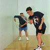 98/02/21 Racquetball Tourn *Dennis Stierer photo - Jeff Thompson, in forground hits the ball during warmups at the YMCA tournament. In the background is Arnie Ruben.