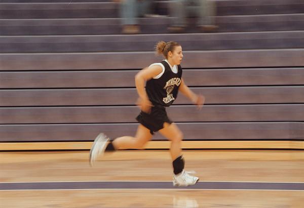 98/11/10 Cheryl Klick - Vino Wong Photo - Cheryl Klick of Niagara University womenÕs basketball team member sprints during workout Tuesday.