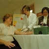 98/11/10 Diabetes Screening - James Neiss Photo - L-R - Cheryl Olson of Phillips Rd. Appelton is tested for Diabetes by Kerri McKay, MT ÒASCPÓ and Lois Begley RN and Education Coordinator. Newfane Inter-Community Memorial Hospital.