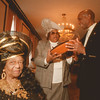 98/03/18 Black Conference - James Neiss Photo - victoria Maxwell of Liberia, West Africa shows off her hat designs to Mary Pelham of Lancaster NY and Black Family Conference Coordinator James Williams of NF. The conference was being held at the Hilton Hotel in Buffalo and is sponsored by Niagara University.