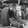 4/22/97-- fixing a car-- Takaaki Iwabu photo-- Darrell Lindsay, 9, helps his father fixing an old vehicle in front of the garage of his house on Walnut Avenue Tuesday. <br /> <br /> grapevine photo