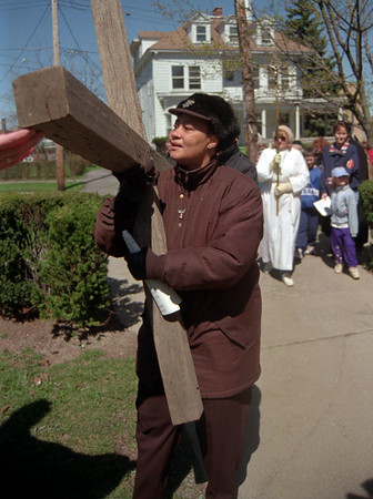 98/04/10 Cross Walk 2-Bette St.Aude from Newfane prays as she carries the cross with fellow parshiner through Lockport.