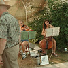 98/08/08 - street strings--Takaaki Iwabu photo-- Eileen Rieger, left, 16, and Meg Gerbasi, 16, perform their classical pieces on Center St. for the visitors to Lewiston Art Festival. <br /> <br /> Grapevine photo