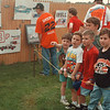6/20/97--speedway 1--Takaaki Iwabu photo-- Danny Andrews, left, Lockport, points at the poster as he and his friends look at the entries of poster contest at Ransomville Speedway Friday. <br /> <br /> sports, Saturday