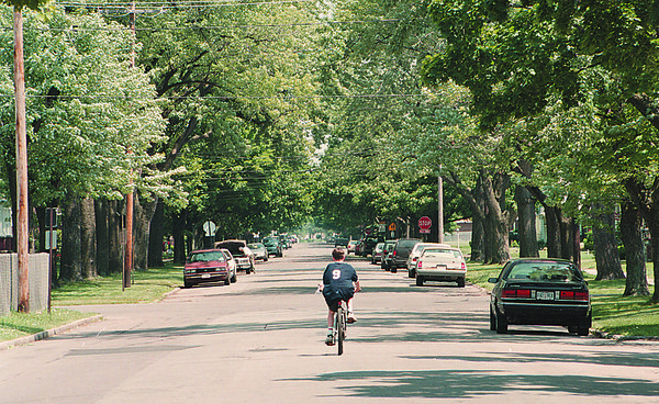 6/21/97-SEX OFFENDER/THE HOOD--DAN CAPPELLAZZO PHOTO--A YOUNG BOY RIDES HIS BIKE DOWN THE 2000 BLOCK OF FOREST AVE WHERE THE SEX OFFENDER LIVES.<br /> <br /> 1A NEWS