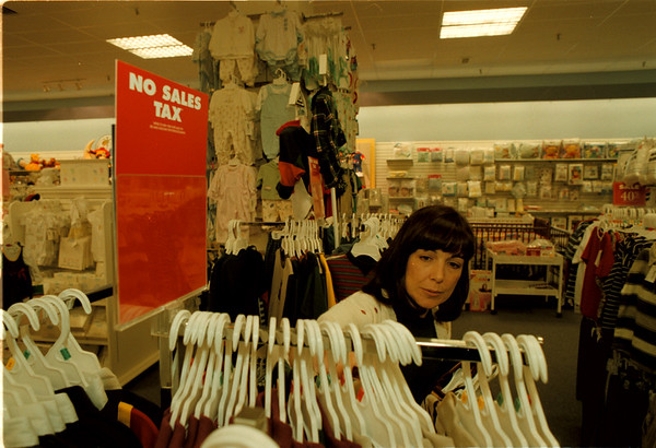 98/09/07 NO SALES TAX 2 - James Neiss Photo - Carol Bettis of 60th street, NF., was out looking buying cloths for her grandson Jacob Conte 5yrs who is going into KG this year.