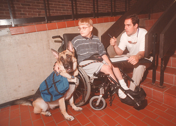 97/08/26 Access - James Neiss Photo - Bruce Oliphant, right , a Lewiston #1 volunteer fire fighter works with Kevin Casper 14yrs and his dog Cami on Identifying and addressing barriers at LewPort High School as he well be going into 9th grade this September.