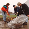 4/12/97-- cleanup-- Brendan McDermid photo-- From left, Jean Marie Lorenz, Mike Wizos and Bill Grout, work together as they come out for claning up flower bed just off Main St. Saturday.