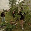 98/06/01 Impact Team - James Neiss Photo - L-R -  Marlowe Smith of NF and Damion Gibson of NF. remove brush cut down by city water dpt. volunteer Rick Willimas, center.  Smith and Gibson were working for community services.  (work fare?).