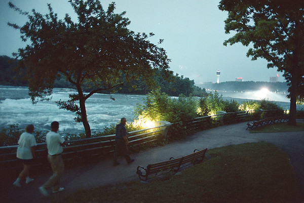 7/2/97--Upper Rapids--Takaaki Iwabu photo--Tourists pass by the upper rapids of Niagara River, where the lights illuminate. (for don's story on lighting project around Goat Island) <br /> <br /> Friday, 1a, color