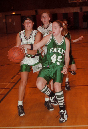 97/12/03 LewPort Girls 2 - James Neiss Photo - Lewport Girls VS Lake Shore in the Niagara Police Athletic League Tip-Off Tournament. LewPort #30 Toni Mauro trys to keep the ball away from Lake Shore #45 Janet Welch in the 2nd qtr.