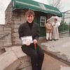 "5/12/97 Walking Tours - James Neiss Photo - Niagara Historic Walking Tours - L-R - Lauren Dimet, Company President, shows off the Guide Book given to walking tour patrons, as ""PerformerGuides"" Tim DiCarlo and Andrea Campagna stand dressed in historic garb ready to give a tour."
