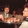2/15/97 Firefighters Ball - James Neiss Photo - Niagara Falls Fire Fighter John Breed digs into the hors d'oeubres'  served by waitress Rose Bondanella at the Radison Hotel, before sitting down for dinner.