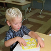98/09/02 Starting Early *Dennis Stierer Photo -<br /> Kelsey Wohleben,3, a Pre-Kindergarden student at DeSales Catholic School can't wait till next week to start drawing and learning as he came right in the classroom and started working.