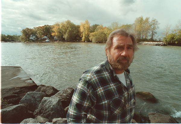 97/10/22 Sunset Island - James Neiss Photo - Anthony Stashak, a Sunset Island resident, is upset about the towns sewer solution for Sunset Island. Here he stands at the Wilson harbor inlet with Sunset Island in the back ground.