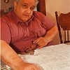 7/25/97--Leo Alcuri--Takaaki Iwabu photo-- Leo Alcuri shows the petitions for his candidacy to Niagara County Legislature Friday at his home on Cleveland Ave. (His candidacy was objected by Dennis Virtuoso and the case will be heard in Supreme Curt Monday.)<br /> <br /> Monday, 1A, color