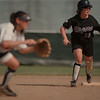 98/05/07 NU Softball-Barbara Hill (right) of Niagara University tries to steal third in the game against Robert Morris College.