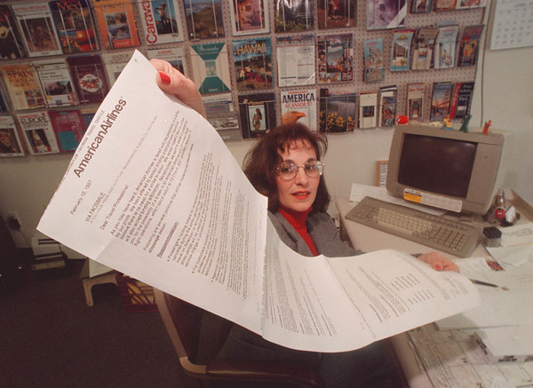 2/14/97 American Airlines - James Neiss Photo - Nancy Farbo Valery, owner of RainbowTravel Service, on Millitary Road in the town of Niagara, shows off a communicay to travel agents from American Airlines outling what can be expected if there is a strike she said.