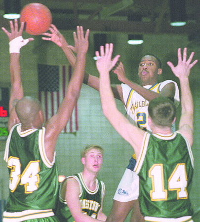 1/8/96-- NCCC --Takaaki Iwabu photo-- NCCC ................. (21) dishes a pass over Jamestown's difenders, from left, ........................(34) .........................(21) and ........................(14). <br /> <br /> sports, Thursday