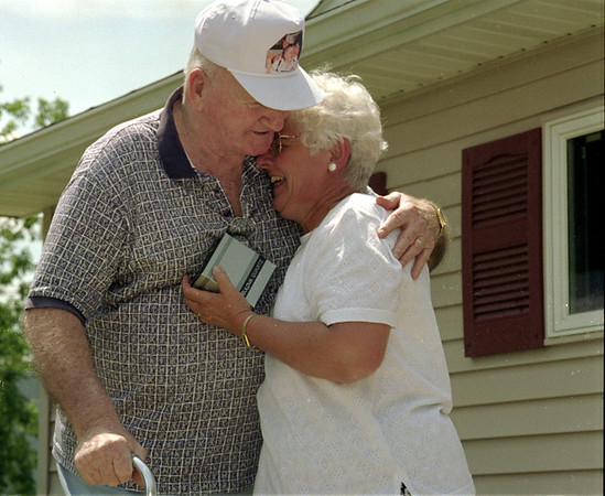 98/08/02 DIRECTOR RETIRES-RACHEL NABER PHOTO-M. Lynn Marciszewski (right) recieves a hug from John Walsh in celebration of her retirement as director of the senior citizens center in Medina.