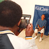 7/12/97--MT. ZION/KIDS CARE--DAN CAPPELLAZZO PHOTO-- MT. ZION VOLUNTEER ARISCO HALES SHOOTS A POLARIOD PhOTO OF 13-YR-OLD REGINALD RENFORD FOR THE KIDS CARE PROGRAM AT MT ZION BAPTIST, CALUMET RD.<br /> <br /> LOCAL