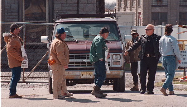4/14/97 Water Plant Picketing - James Neiss Photo - Niagara Falls Police Officer Ronald Petrino assists a non-union contractor employee leave the old Water Plant on Buffalo Ave. Laborers form Union Local 91 protest.