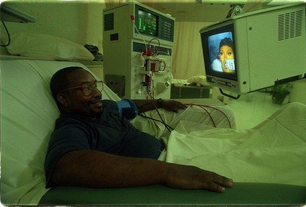 7/2/97 Dialysis Clinic - James Neiss Photo - Terry Wynn, 35yrs of Niagara Falls, gets comfortable watching music videos, as he begins his 3 to 4 hour Kidney Dialysis Treatment at the Niagara Dialysis Clinic.