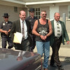 98/08/17 DrinkwalterArrainged *Dennis Stierer photo -<br /> Ronald Drinkwalter, 43, of 1012 Youngstown-Lockport Road is shown being led out of  Porter Town Court by Investigators Daniel P. Brown (left) and Daniel Fritton of the Sheriffs Department on Monday afternoon after he was arrainged. Following them is Deputy Richar Zachary and David Broderick. Drinkwalter had eluded the police for more than a week.