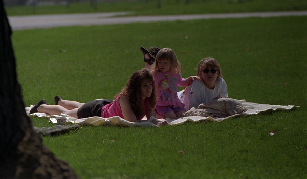 98/04/13 Catchin' Sun Rays *Dennis Stierer photo - These three were enjoying the great sunshine on Monday at Outwater park. From left they are Lori Wallace, her daughter Nicole, 3; and Emily Harvey.