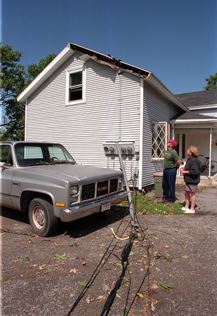 98/09/07 Ripped Away *Dennis Stierer Photo -<br />  Edward Pettitt, owner of the house at 2044 Lockport Olcott Road, along with his tenant, Patricia Flatt survey the damage that happened last night as a storm ripped through Burt, NY.