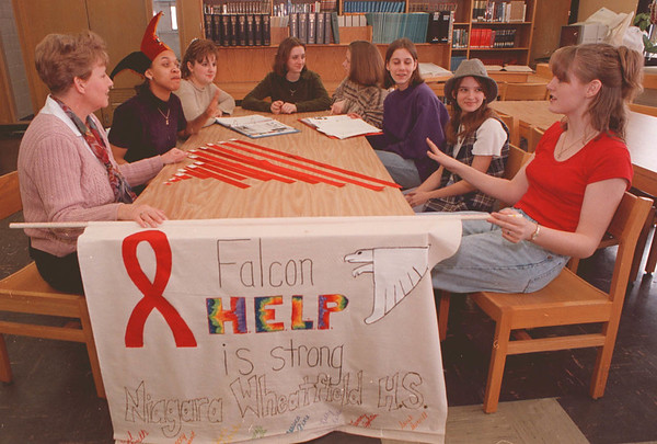 2/13/97--NW AIDES AWARENESS--DAN CAPPELLAZZO PHOTO--(LTOR) ADVISOR MRS. CHASE, SPARKLE NALLS, JESSICA FIORE, APRIL SMITH, MARCEY BRYANT, JESSICA SIKORSKI, SARAH AVERILL AND TAMMY APPLETON TALK ABOUT THE DEADLY KILLER OF THE 90'S.<br /> <br /> ECHO