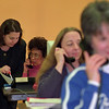 4/22/97--JOBS/TELE COMMUNITCATON 2--DAN CAPPELLAZZO PHOTO--JOAN CALDWELL, AN NF BOARD OF EDUCATION INSTRUCTOR HELPS TELECOMMUNICATIONS PRE SEVICE STUDENT CHALOR HARTMAN, OF NF AT A TRAINING SESSION AT NF COMMUNITY ED CENTER. (WALNUT AVE)