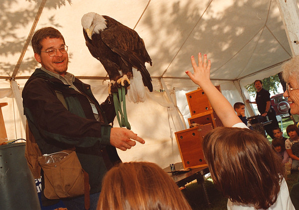 97/09/27 Wildlife Fest--Takaaki Iwabu photo-- Paul Schnell holds a bold-eagle as he answers to the questions from crowd during Power Authority's annual Wildlife Festival in Academy Park in Lewiston.  (The Festvial is being run in conjunction with Harvest Festival) <br /> <br /> local, color Sunday