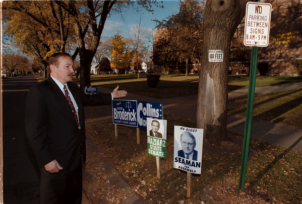 98/11/03 Kevin Burns - James Neiss Photo - Says campaign signs infront of school on Gilmore Ave. in North Tonawanda are too close to poling place and violate rules.