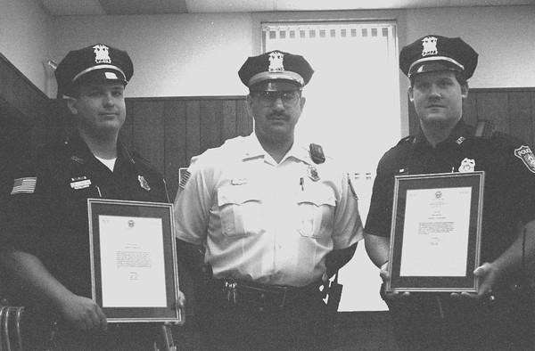 98/06/03 Police Awards-Rachel Naber photo-(left to right) Eric Harling recieved  police chief Jose Avila award along with John Doyle.