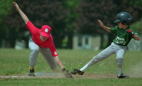 98/05/16 Anjo BB-Rachel Naber Photo-T.J. Garlock (left) attempts the tag as Peter Bower makes it safely to third base at the opening game of the AN-JO baseball.