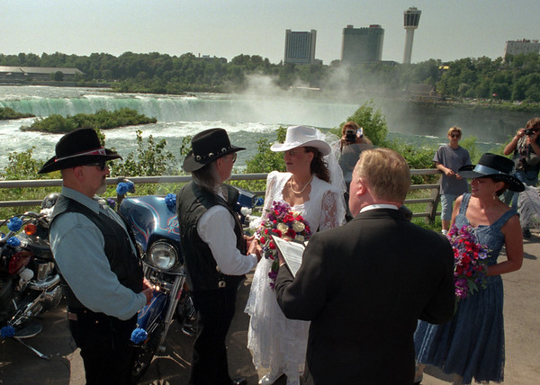 98/09/05 Wedding *Dennis Stierer Photo -<br /> Mayor James C. Galie received a rare treat on Saturday as he married Stepon K. Jamgochian and Loretta Lynch at Terripin Point on Gaot Island infront of a row of motorcycles. Standing in for best man was George Waterstram and Linda O'Neill.