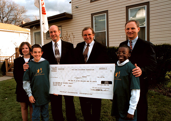 98/11/06 BigBrothersBigSisters *Dennis Stierer Photo -<br /> Big Brothers, Big Sisters inLockport received a nice donation from Fretthold Funeral Home. From left in the Photo is Jodi Fender, Senior Caseworker, BB/BS; Donald M., Little Brother; Jim Fretthold; Fretthold Funeral Home;  Fred Lenz, York Children's Foundation; Rashell M., Little Sister; and Jim Niland, Chairman of Big Brothers, Big Sisters. SEE ALSO PRESS RELEASE.