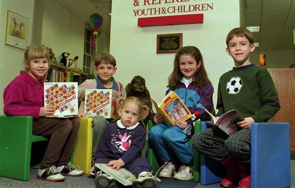 98/02/05 Winter Readers *Dennis Stierer photo - (L-R):  Lauren Scarupa, 6;  James Knapp,7:  Megan Schneider, 2;  Christina Knapp,8;  and Kevin Miller, 7.