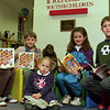 98/02/05 Winter Readers *Dennis Stierer photo - (L-R):  Lauren Scarupa, 6;  James Knapp,7:  Megan Schneider, 2;  Christina Knapp,8;  and Kevin Miller, 7.