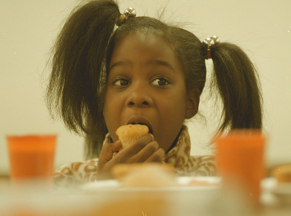 98/03/10 --snack time--Takaaki Iwabu photo-- Brittany Searight, 7, enjoys cookies and muffins during the snack time at Niagara Community Center (on 15th and Center st.) Tuesday. <br /> <br /> grapevine photo