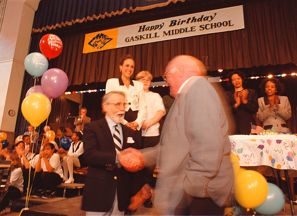4/18/97 -- Gaskill MS 1 --Takaaki Iwabu photo-- Gaskill Middle School graduates representing from 1930s to 1990s go up to the stage for the cake-cutting during the School's 65th year birthday event Friday. <br /> <br /> local, Saturday