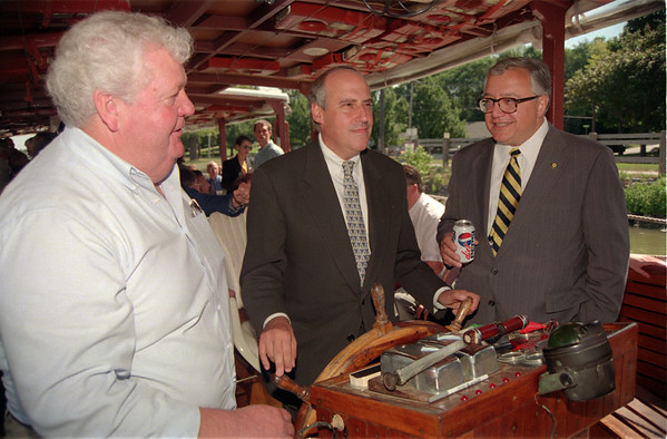 98/08/13 Canal 4-Rachel Naber Photo-Mike Murphy (left) owner of Locport Locks and Canal Cruises speaks to Congressman John Lafalce (right) as Secretary of Agriculture tries his hand at steering the tour boat down the Erie canal.