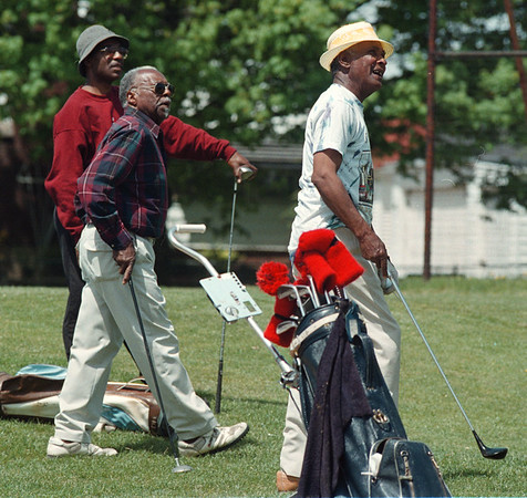 5/24/97-- golfers --Takaaki Iwabu photo-- From left, Lomax Barnes, Carter L. Willie and Joe Stephens watch the ball their companion hits as they enjoy golfing at Hyde Park Golf Course Saturday. ---for Bill's story on Tiger Woods effect... <br /> <br /> sports, Sunday, color