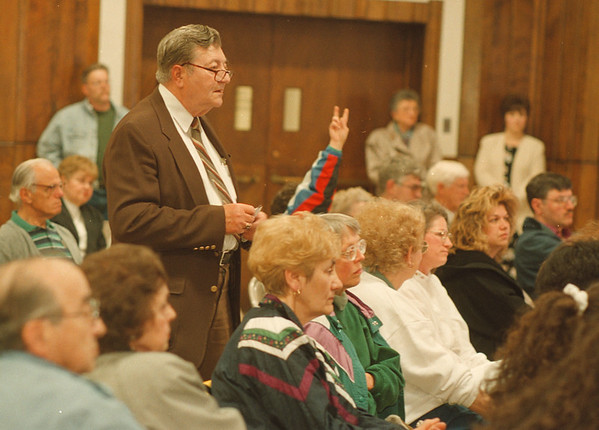 5/22/97--board meeting 2--Takaaki Iwabu photo-- Many locals showed up to Thursday's school board meeting to express their concern on the new school building issue. Standing as he speaks up is George McKedy.